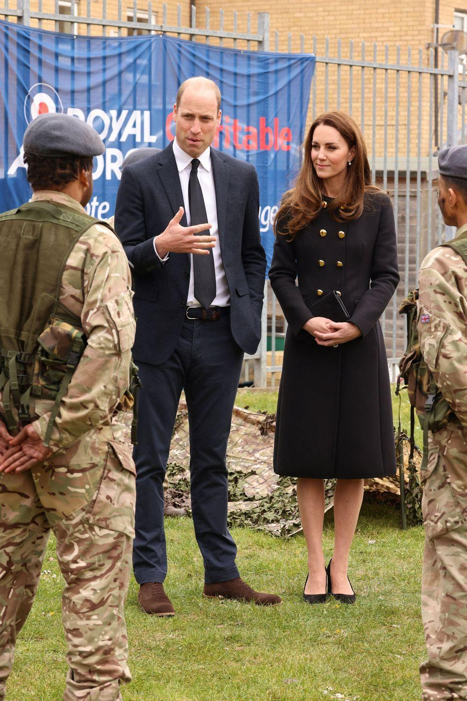 <p>The Duke and Duchess of Cambridge visited Air Cadets in East London, and paid tribute to the late Duke of Edinburgh. As the royal family was still in their period of mourning during this engagement, Kate wore an all-black ensemble. <br></p>