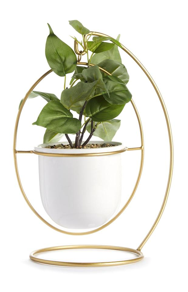 <p>Hanging plant pot in gold, £10.00</p>