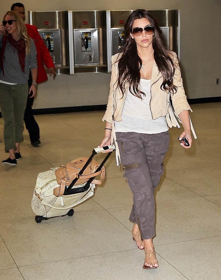 """Meanwhile, in New York City, bride-to-be Kim Kardashian arrived at John F. Kennedy International Airport. """"Back in NY and it feels so good! I've missed u so much!!!"""" the """"Keeping Up With the Kardashians"""" hottie tweeted. <a href=""""http://www.infdaily.com"""" target=""""new"""">INFDaily.com</a> - August 4, 2011"""