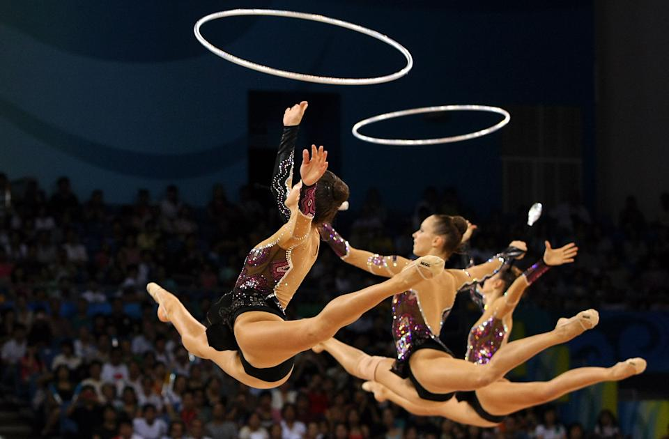 BEIJING - AUGUST 24: The Bulgarian team perform in the 3 Hoops and 2 Clubs rotation in the Group All-Around Final held at the Beijing University of Technology Gymnasium during Day 16 of the Beijing 2008 Olympic Games on August 24, 2008 in Beijing, China. (Photo by Nick Laham/Getty Images)