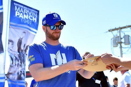 NASCAR Cup Series driver Dale Earnhardt Jr. (88) signs autographs before the 2017 Daytona 500 at Daytona International Speedway. Mandatory Credit: Jasen Vinlove-USA TODAY Sports