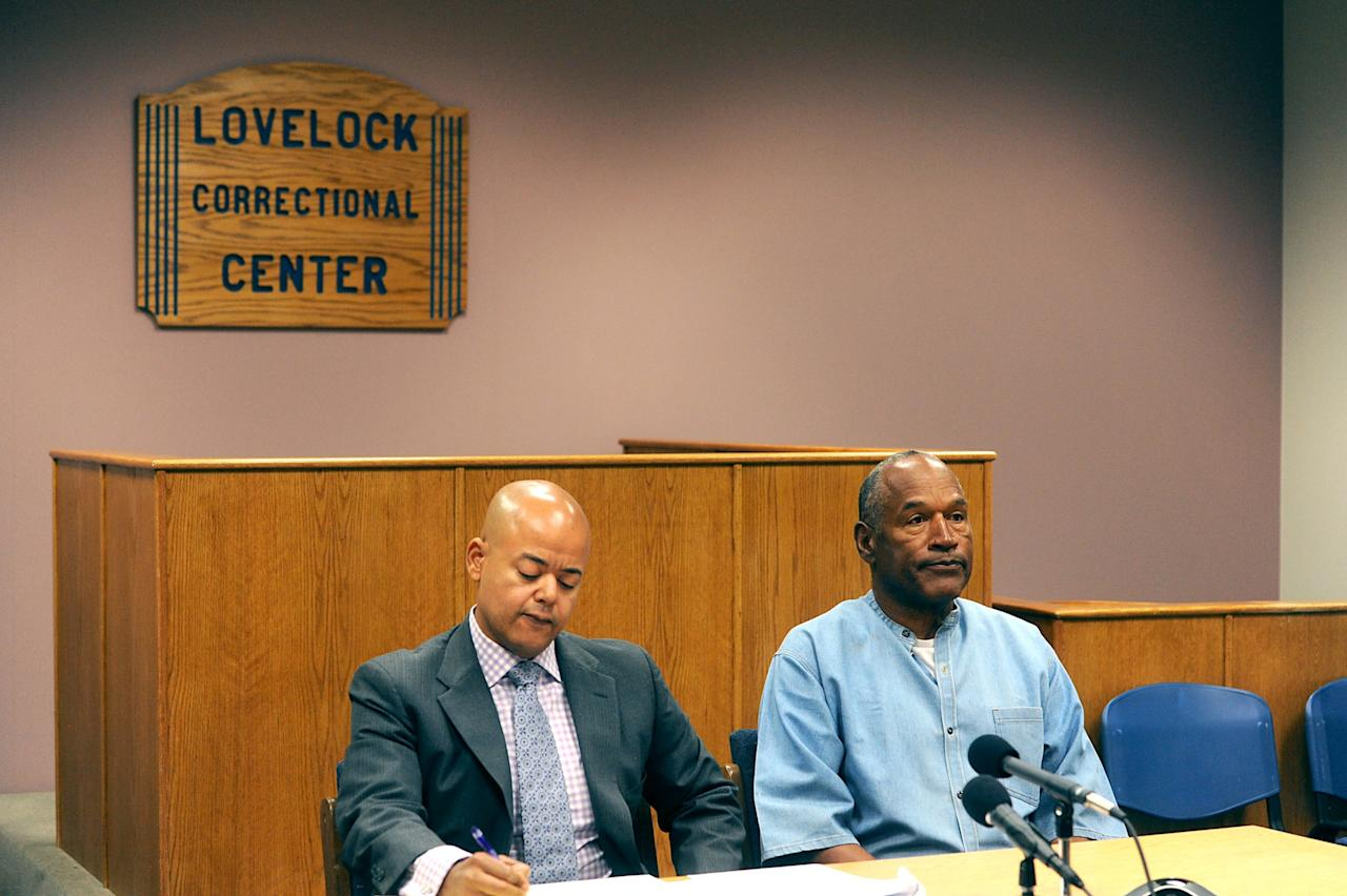 <p>LOVELOCK, NV – JULY 20: O.J. Simpson (R) attends his parole hearing with his attorney Malcolm LaVergne at Lovelock Correctional Center July 20, 2017 in Lovelock, Nevada. Simpson is serving a nine to 33 year prison term for a 2007 armed robbery and kidnapping conviction. (Photo by Jason Bean-Pool/Getty Images) </p>