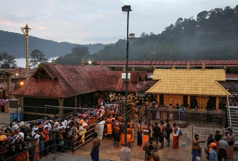 FILE PHOTO: Hindu devotees wait in queues inside the premises of the Sabarimala temple in Pathanamthitta