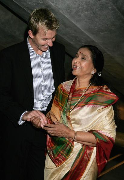 "SYDNEY, AUSTRALIA - MARCH 08:  Indian singer Asha Bhosle and Australian cricketer Brett Lee attend a photo call to promote their forthcoming two night performance at The Utzon Room at the Sydney Opera House on March 8, 2007 in Sydney, Australia. In 2006, cricketer Brett Lee wrote the lyrics, played the guitar and sang a duet with Asha Bhosle for ""You are the One for Me"", which took the Indian charts by storm. The company performs two nights in Sydney before heading to Adelaide and Melbourne.  (Photo by Patrick Riviere/Getty Images)"