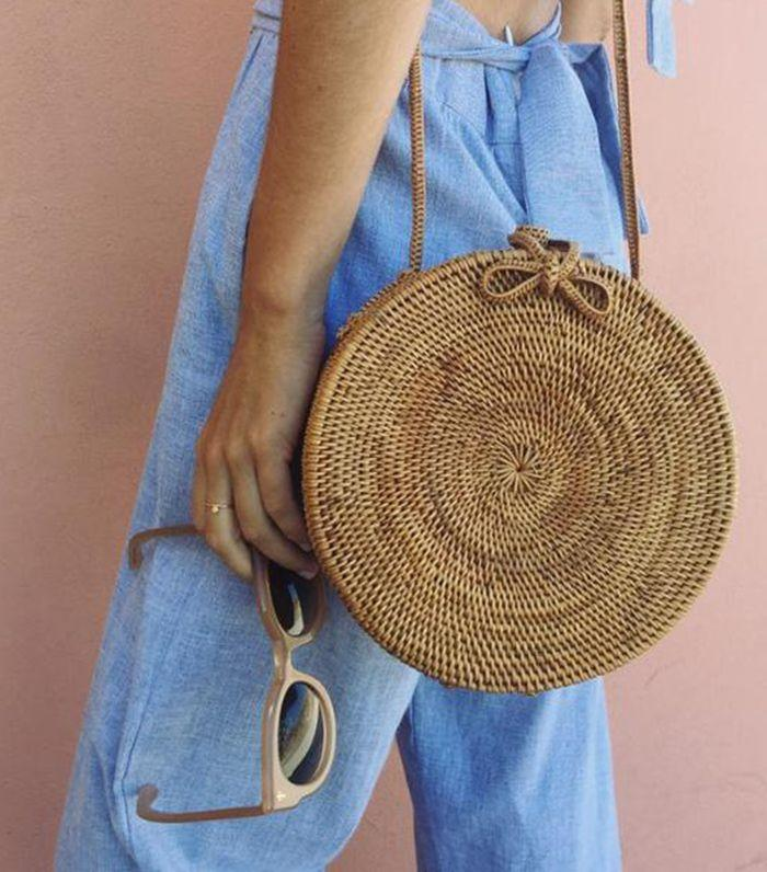 Jeanne Damas has been spotted sporting a circle woven bag.