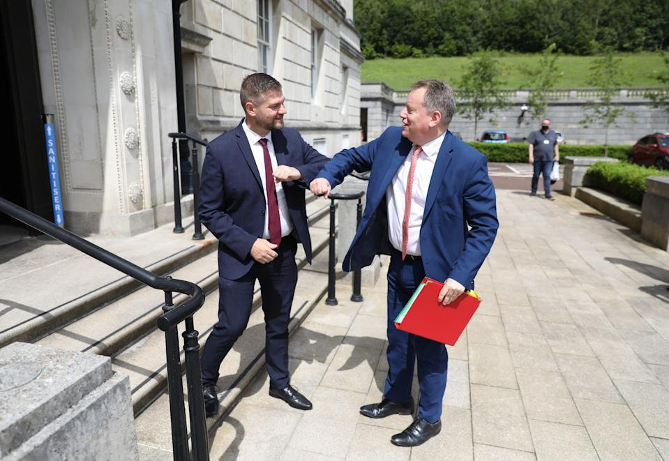 Colin McGrath from the SDLP and chairman of the Executive Office Committee greets Brexit minister Lord Frost (PA Wire)