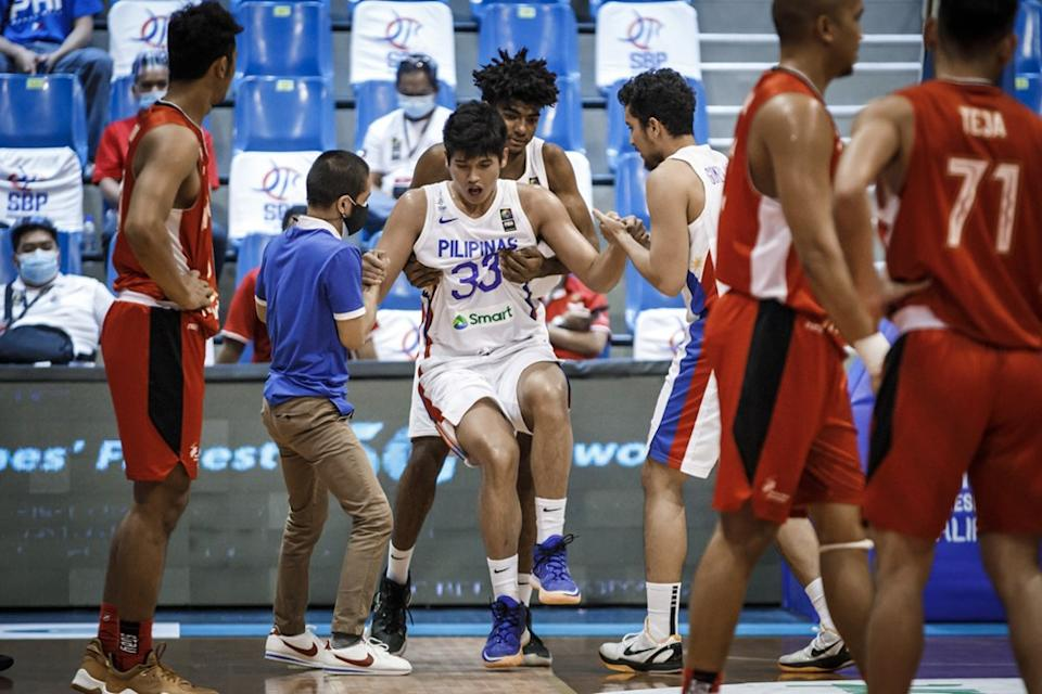Gilas Pilipinas player Carl Tamayo suffered an injury in the match against Indonesia last June 18. (Photo: FIBA Basketball)