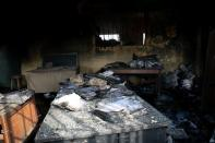 Burnt prison books are seen on the table after gunmen attacked and set the prison facility ablaze in Imo State