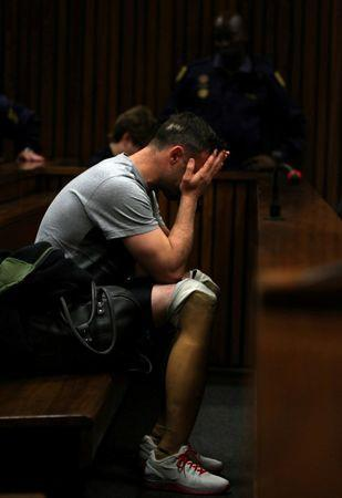 FILE PHOTO Paralympic gold medalist Oscar Pistorius, seen with his prosthetic legs, reacts during the third day of the re-sentencing hearing for the 2013 murder of his girlfriend Reeva Steenkamp, at Pretoria High Court, South Africa June 15, 2016. REUTERS/Siphiwe Sibeko/File Photo