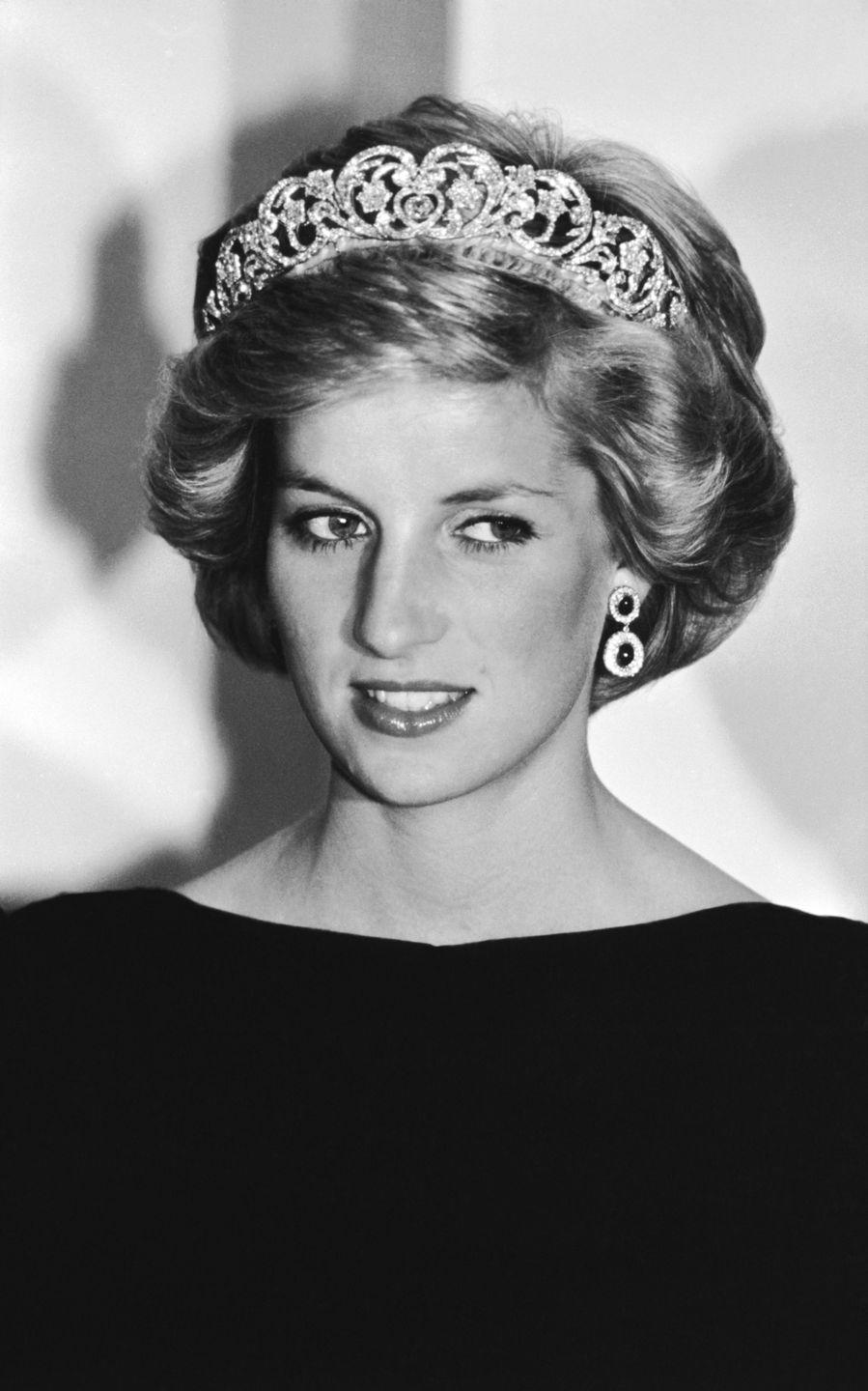 <p>Looking like an Old Hollywood movie star in this black-and-white shot—taken at a state dinner in Canberra, Australia—Diana wears the Spencer tiara. </p>