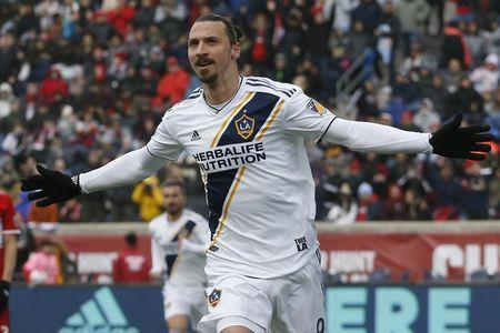 Apr 14, 2018; Chicago, IL, USA; Los Angeles Galaxy forward Zlatan Ibrahimovic (9) celebrates his goal against Chicago Fire during the first half of MLS soccer action at Bridgeview Stadium. Mandatory Credit: Jim Young-USA TODAY Sports