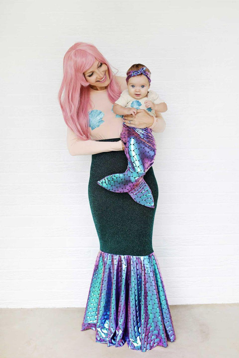 """<p> You and your little one will get along swimmingly as gorgeous sea creatures, matching mermaid tails and all. </p><p><strong>Get the tutorial at <a href=""""https://abeautifulmess.com/2017/10/mother-daughter-mermaid-costume-diy.html"""" rel=""""nofollow noopener"""" target=""""_blank"""" data-ylk=""""slk:A Beautiful Mess"""" class=""""link rapid-noclick-resp"""">A Beautiful Mess</a>.</strong></p><p><a class=""""link rapid-noclick-resp"""" href=""""https://go.redirectingat.com?id=74968X1596630&url=https%3A%2F%2Fwww.etsy.com%2Flisting%2F384830682%2Fmermaid-scale-fabric-iridecent-color&sref=https%3A%2F%2Fwww.countryliving.com%2Fdiy-crafts%2Fg28181767%2Fmom-halloween-costumes%2F"""" rel=""""nofollow noopener"""" target=""""_blank"""" data-ylk=""""slk:SHOP MERMAID SCALE FABRIC"""">SHOP MERMAID SCALE FABRIC</a></p>"""
