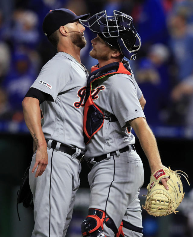 Detroit Tigers relief pitcher Shane Greene, left, and catcher John Hicks, right, celebrate following the team's baseball game against the Kansas City Royals at Kauffman Stadium in Kansas City, Mo., Wednesday, June 12, 2019. The Tigers won 3-2. (AP Photo/Orlin Wagner)