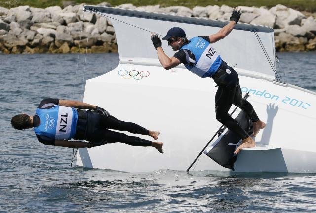 New Zealand's Peter Burling (R) and Blair Tuke celebrate winning silver in the 49er sailing class at the London 2012 Olympic Games in Weymouth and Portland, southern England, August 8, 2012. REUTERS/Pascal Lauener (BRITAIN - Tags: SPORT YACHTING OLYMPICS TPX IMAGES OF THE DAY)