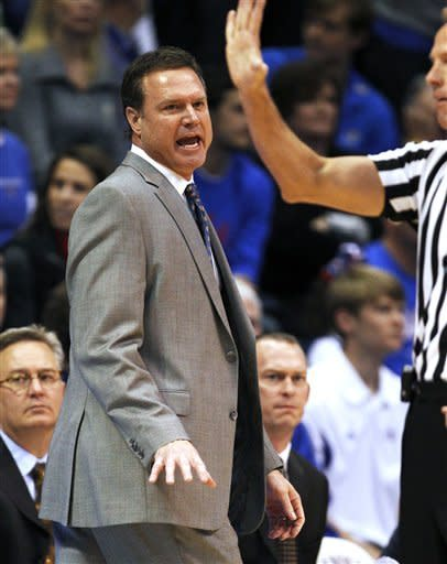 Kansas coach Bill Self questions an official during the first half of an NCAA college basketball game against Iowa State in Lawrence, Kan., Saturday, Jan. 14, 2012. (AP Photo/Orlin Wagner)