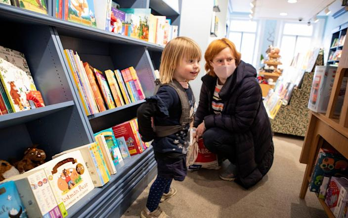 Leonora introduces two-and-half-year-old Elsa to the joys of book shopping - Rii Schroer