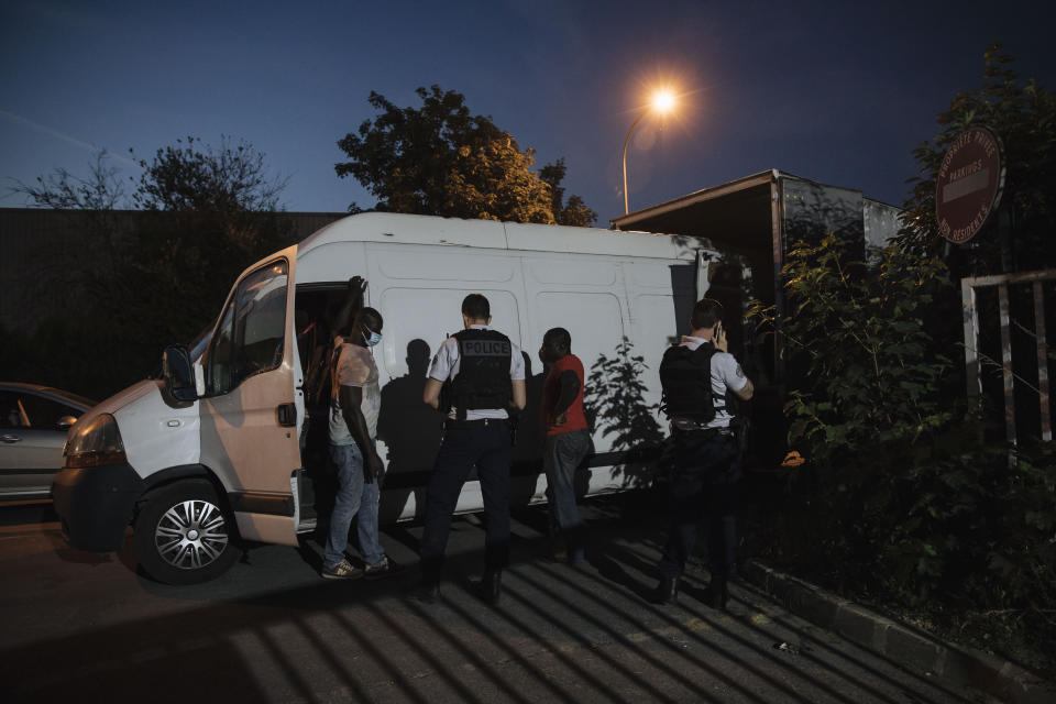 Police officers check people driving a van in the Paris suburb of Sarcelles, Tuesday, June, 15, 2021. In the run-up to France's presidential elections in 2022, crime and policing are again becoming hot-button issues. Some political opponents of President Emmanuel Macron argue that France is becoming an increasingly violent country. (AP Photo/Lewis Joly)