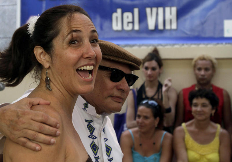 FILE - In this Aug. 12, 2011 file photo, daughter of Cuba's President Raul Castro, Mariela Castro, and Nicaragua's late political writer Tomas Borge, attend a celebration marking the 10th anniversary of the National Center for Sex Education, CENESEX, in Havana, Cuba. On the eve of her controversial arrival in the United States to attend a conference on Latin America Thursday, May 24, 2012, prominent academics say the 49-year-old Cuban first daughter has carved out an important name for herself that goes beyond her family lineage or famous last name, making gay rights her life's cause. (AP Photo/Franklin Reyes, File)