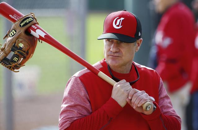 FILE - In this Feb. 18, 2019, file photo, Cincinnati Reds manager David Bell watches his players warm up at the team's spring training baseball facility in Goodyear, Ariz. (AP Photo/Ross D. Franklin, File)