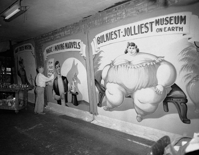 <p>Fred Johnson, 67, a banner artist of the old school, puts the final touches to huge banners on July 14, 1959 to be used in the new circus museum being installed at Baraboo, Wis. where the John Ringling Bros., circus began. Johnson still plys his art with a Chicago tent and awning firm. He began painting circus banners in 1909. (AP Photo/Edward Kitch) </p>