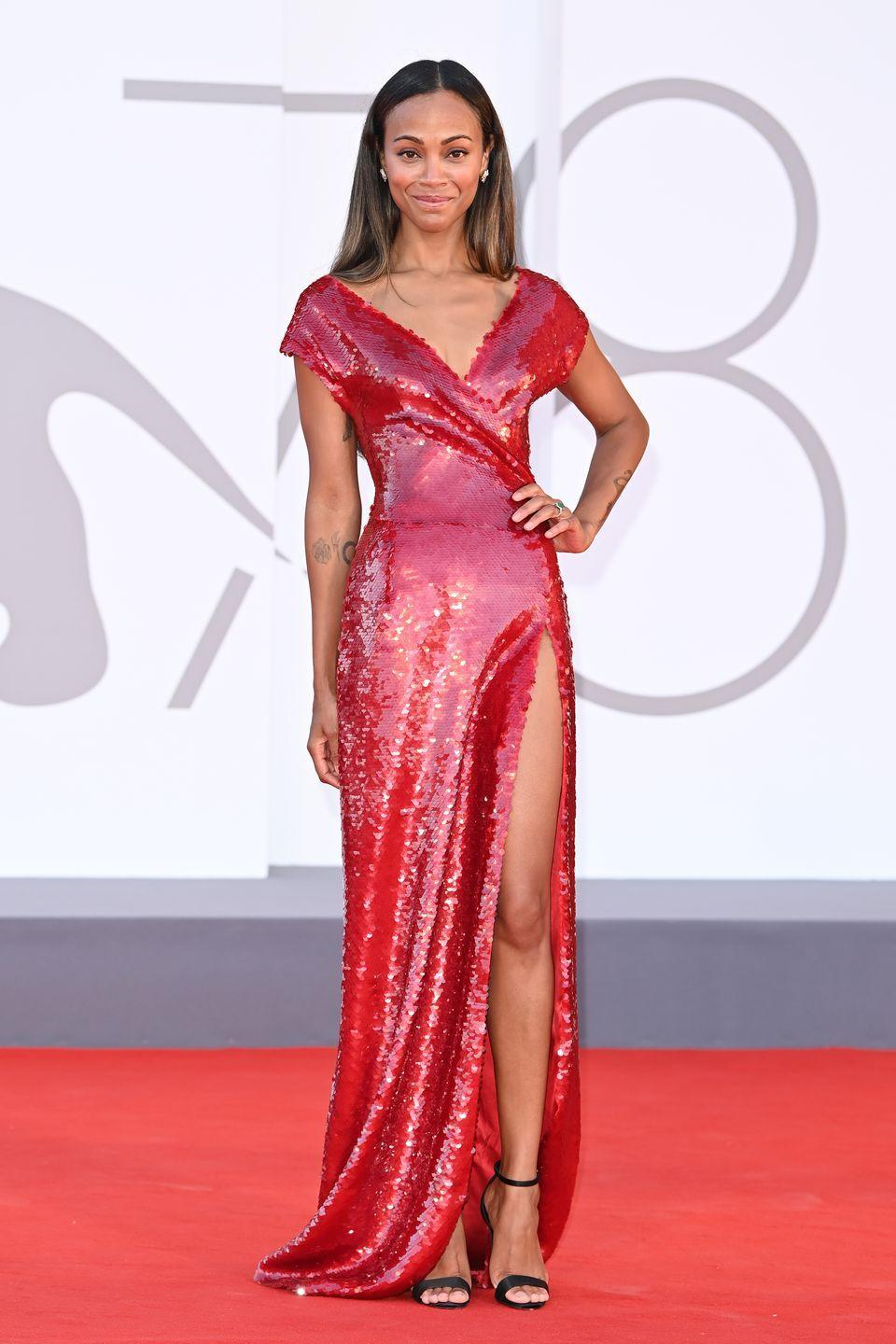 <p>Avatar actress Zoe Saldana shimmered in an off-the-shoulder red sequin gown.</p>
