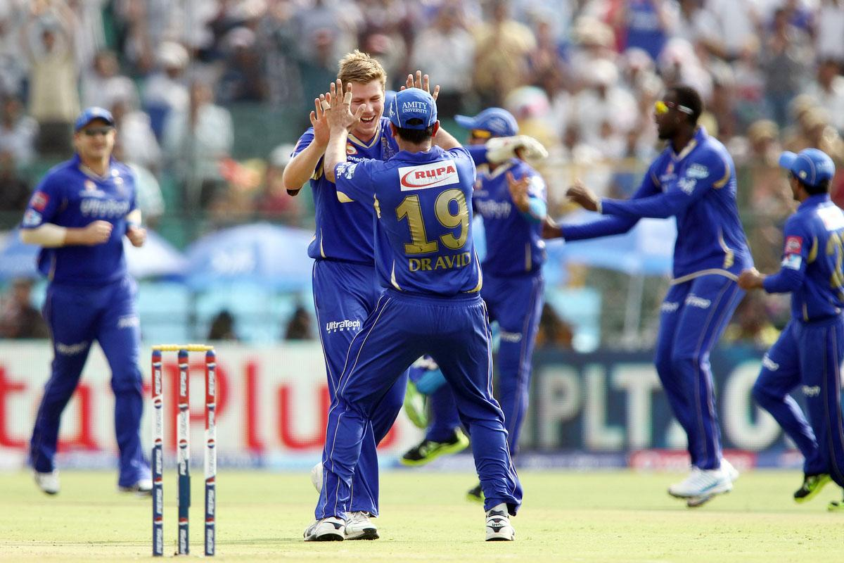 James Faulkner of Rajasthan Royals is congratulated by Rajasthan Royals captain Rahul Dravid after getting Shikhar Dhawan of Sunrisers Hyderabad wicket during match 36 of the Pepsi Indian Premier League (IPL) 2013 between The Rajasthan Royals and the Sunrisers Hyderabad held at the Sawai Mansingh Stadium in Jaipur on the 27th April 2013. (BCCI)