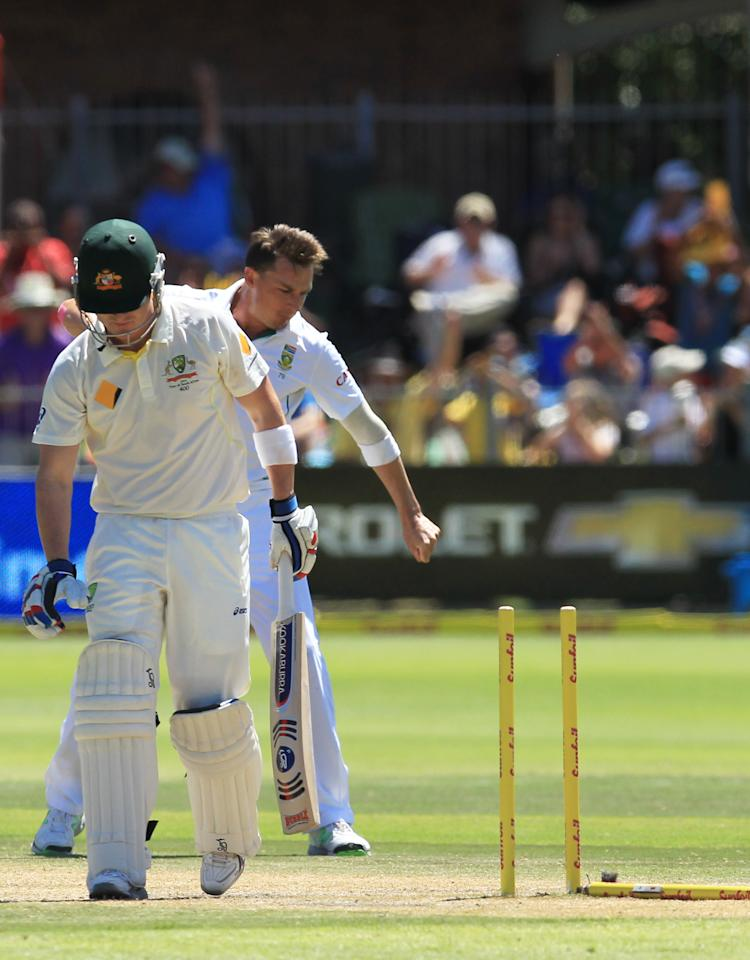 Australia's batsman Brad Haddin, left, leaves the crease after bowled by South Africa's bowler Dale Steyn, right, for 9 runs on the third day of their second cricket test match at St George's Park in Port Elizabeth, South Africa, Saturday, Feb. 22, 2014. (AP Photo/ Themba Hadebe)