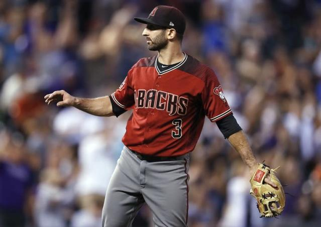 Arizona Diamondbacks infielder-turned-relief-pitcher Daniel Descalso calls for a new ball after giving up a three-run home run to Colorado Rockies' Carlos Gonzalez. (AP)