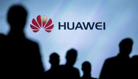 FILE PHOTO: Journalists follow the presentation of a Huawei smartphone ahead of the IFA Electronics show in Berlin