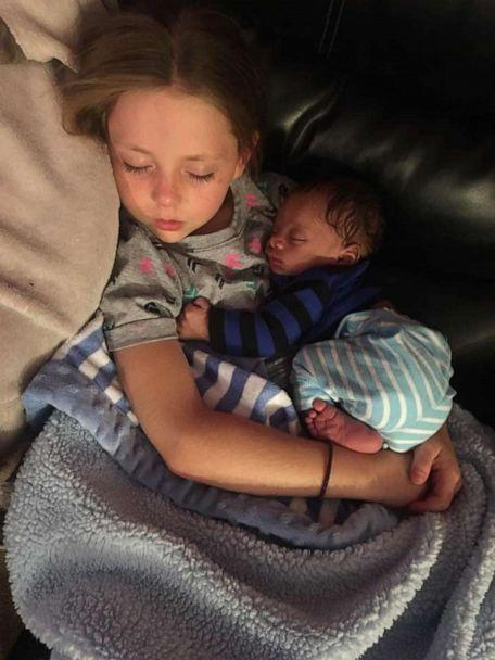 PHOTO: Giana Fessenden, 8, is seen holding her adopted brother Mason. (The Fessenden Family)