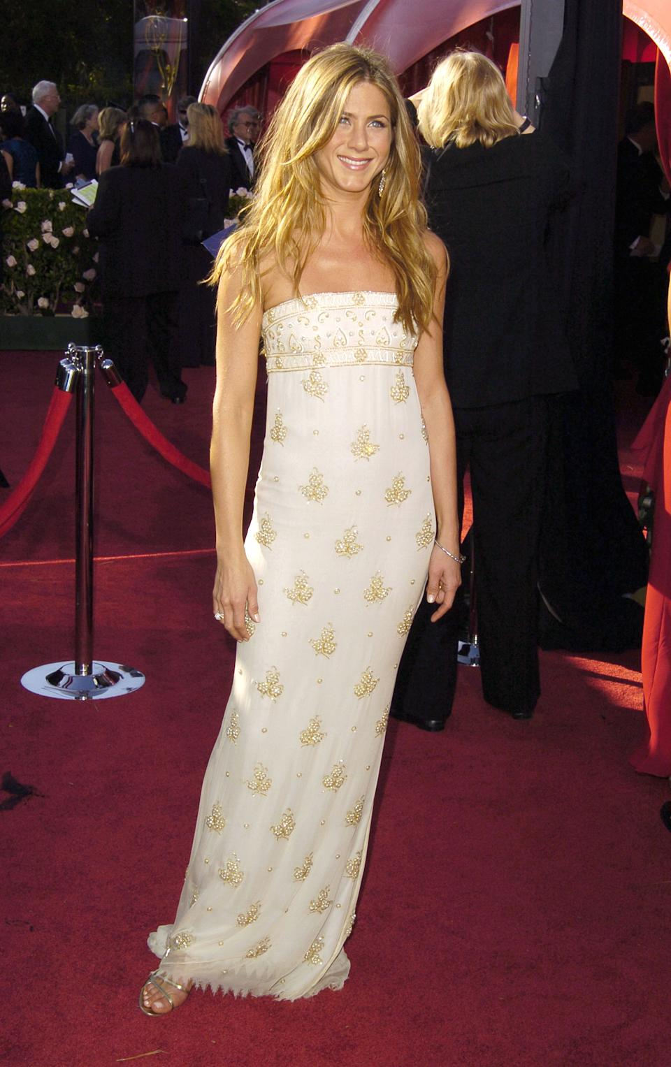 Aniston was the epitome of sun-kissed glamour in this grecian-inspired Chanel gown at the 2004 Emmy Awards. (Photo by SGranitz/WireImage)