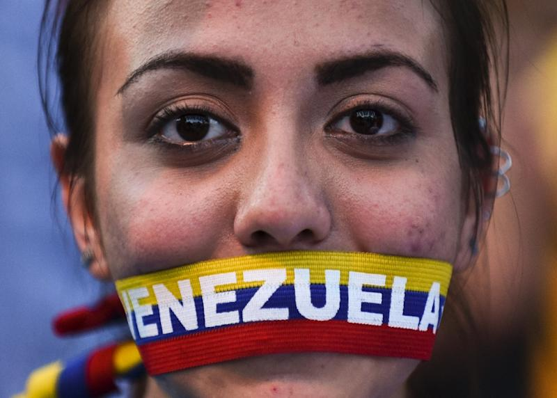 Analysts warn a tough political struggle lies ahead after President Nicolas Maduro's rivals broke his side's 16-year control of the National Assembly in elections (AFP Photo/Luis Robayo)