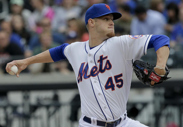 New York Mets starting pitcher Zack Wheeler delivers against the Arizona Diamondbacks during the first inning of a baseball game, Saturday, May 24, 2014, in New York. (AP Photo/Julie Jacobson)
