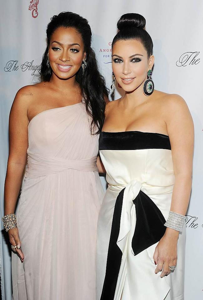 """Ta-da! Kim's finished look included a strapless black and white dress, a fancy updo, and her BFF La La Vazquez by her side. """"Heading to The Angel Ball with @lala! Its an event for cancer research, can't wait to share my story tonight & honor my dad!"""" she tweeted.  Jamie McCarthy/WireImage.com - October 17, 2011"""