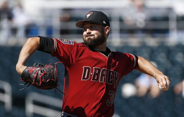 FILE - In this Feb. 26, 2018, file photo, Arizona Diamondbacks pitcher Robbie Ray throws against the Cincinnati Reds during the first inning of a spring training baseball game, in Goodyear, Ariz. The Diamondbacks were one of baseballs big surprises a year ago. The surprise this year would be if they dont keep winning. (AP Photo/Ross D. Franklin, File)