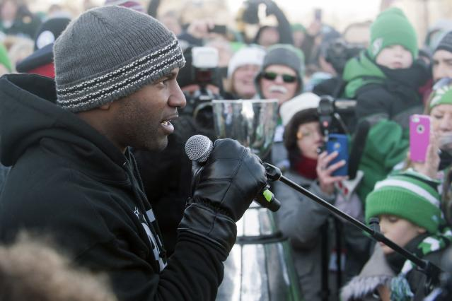 Saskatchewan Roughriders quarterback Darian Durant speaks to a large crowd of fans outside the Saskatchewan Legislative building after the Grey Cup parade on Tuesday Nov. 26, 2013 in Regina, Saskatchewan. The Saskatchewan Roughriders defeated the Hamilton Tiger-Cats 45-23 in the 101st CFL Grey Cup football game. (AP Photo/The Canadian Press, Liam Richards)