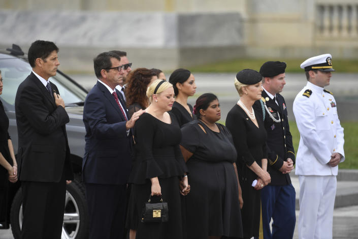 The family of Sen. John McCain, R-Ariz., including from left, Andrew McCain, Doug McCain, second from left, Meghan McCain, from front row left, Bridget McCain, Cindy McCain, Jimmy McCain and Jack McCain, watch as the casket is carried down the steps of the U.S. Capitol in Washington, Saturday, Sept. 1, 2018, in Washington, for a departure to the Washington National Cathedral for a memorial service. (Marvin Joseph/The Washington Post via AP, Pool)