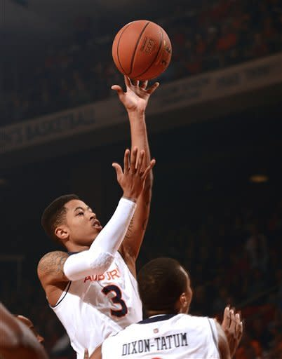 Auburn's Chris Denson shoots against Mississippi in the first half of their NCAA college basketball game on Saturday, Jan. 26, 2013 in Auburn, Ala. (AP Photo/Todd J. Van Emst)