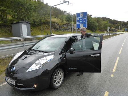 Arne Nordboe gets into his Nissan Leaf electric car in Finnoey, Norway September 8, 2017. Picture taken September 8, 2017. REUTERS/Alister Doyle