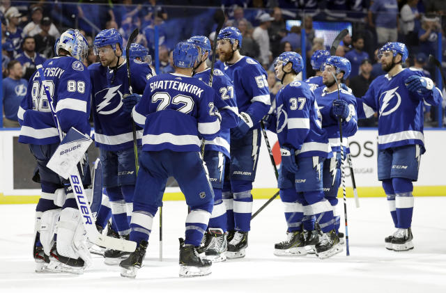 Tampa Bay Lightning players line up to celebrate with goaltender Andrei Vasilevskiy (88) after the team defeated the Florida Panthers in an NHL hockey game Thursday, Oct. 3, 2019, in Tampa, Fla. (AP Photo/Chris O'Meara)