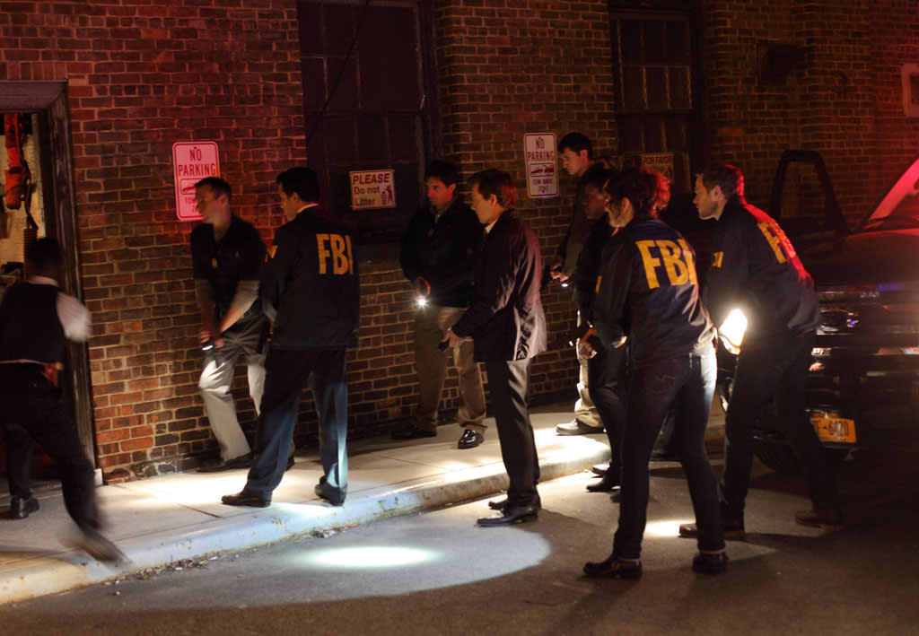 "Ryan Hardy (Kevin Bacon) and the FBI team go into a warehouse in the ""Let Me Go"" episode of ""The Following."""