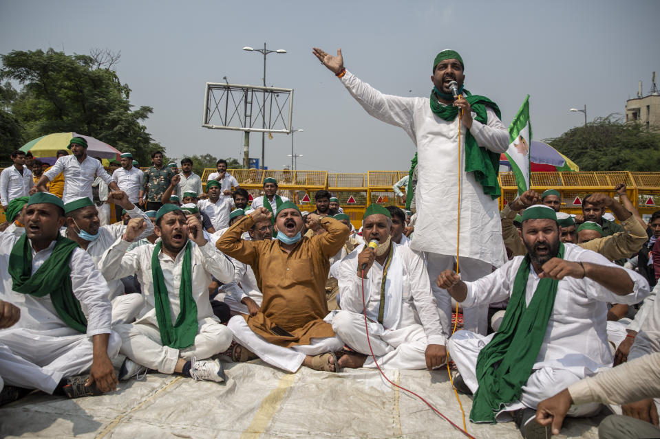 Indian farmers shout slogans as they block a highway during a protest in Noida, India, Friday, Sept. 25, 2020. (AP Photo/Altaf Qadri)