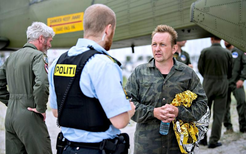 Danish submarine owner and inventor Peter Madsen lands with the help of the Danish police in Dragor Harbour - REUTERS