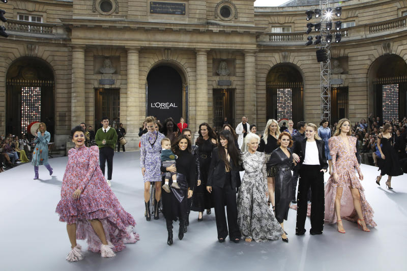 Actresses Aishwarya Rai, from front left, Eva Longoria, carrying her son Santiago Enrique Baston, singer Camila Cabello, actress Dame Helen Mirren, singer Geri Horner, actress Amber Heard and model Doutzen Kroes wear creations as part of the L'Oreal Ready To Wear Spring-Summer 2020 collection, unveiled during the fashion week, in Paris, Saturday, Sept. 28, 2019. (Photo by Vianney Le Caer/Invision/AP)