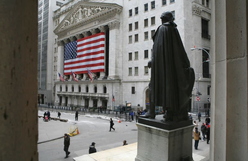 FILE PHOTO: A statue of George Washington is seen on Wall St. across the New York Stock Exchange