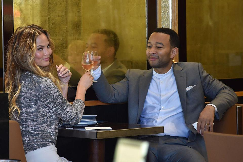 <p>Teasing the paparazzi and enjoying a glass of wine during Paris Fashion Week.</p>