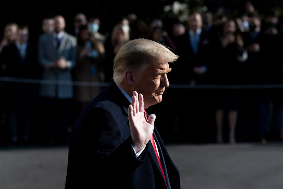 Pictured is a waving Donald Trump.