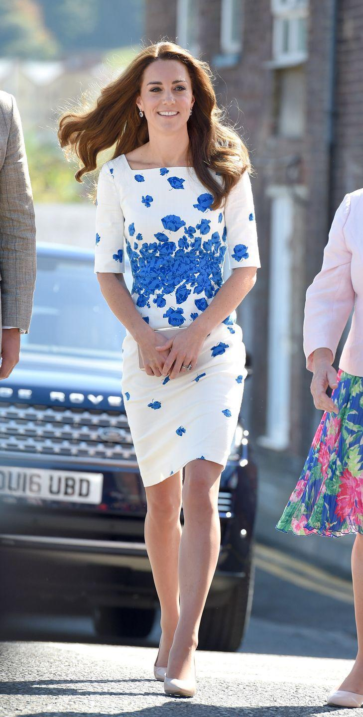 <p>The Duchess wears a chic blue and white floral dress by L.K. Bennett with a nude clutch and matching heels while visiting the Youthscape Center in Luton with Prince William. </p>