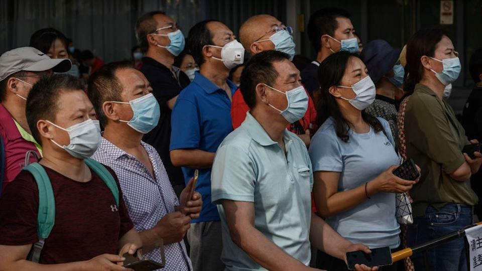 Parents wait nervously outside exam sites as their children take the Gaokao