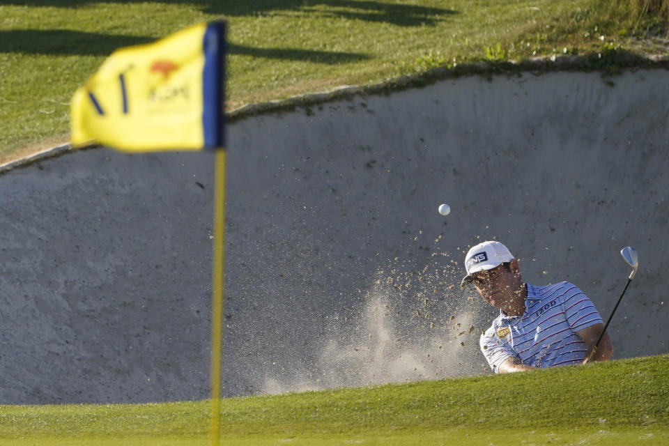 Louis Oosthuizen, of South Africa, hits out of the bunker on the 17th hole during the second round of the PGA Championship golf tournament on the Ocean Course Friday, May 21, 2021, in Kiawah Island, S.C. (AP Photo/Chris Carlson)
